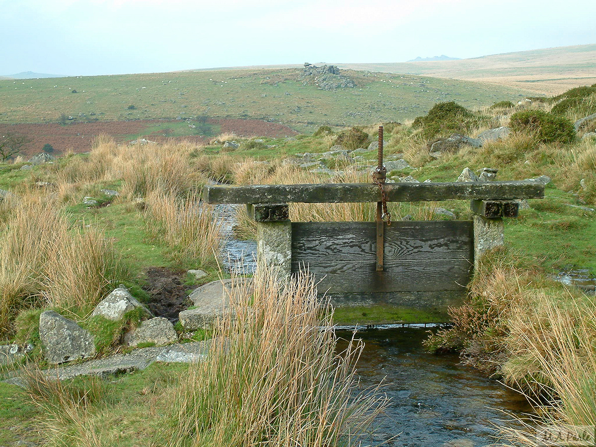 A sluice gate on the Devonport Leat, with Black Tor beyond